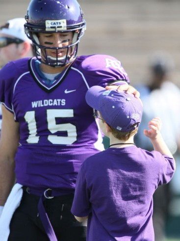 ACU senior quarterback Mitchell Gale stops to visit with his young friend before the Wildcats' – and Rex's – final home game of the 2012 season.