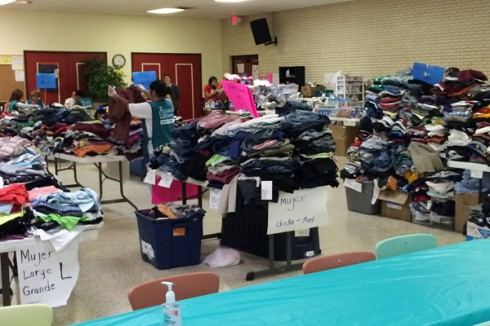 Clothes, sorted by size, are prepared for refugees to choose from at the Sacred Heart Catholic Church in McAllen, Texas.