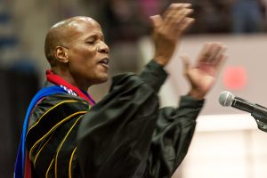 Moore asks grads to shower the world with love