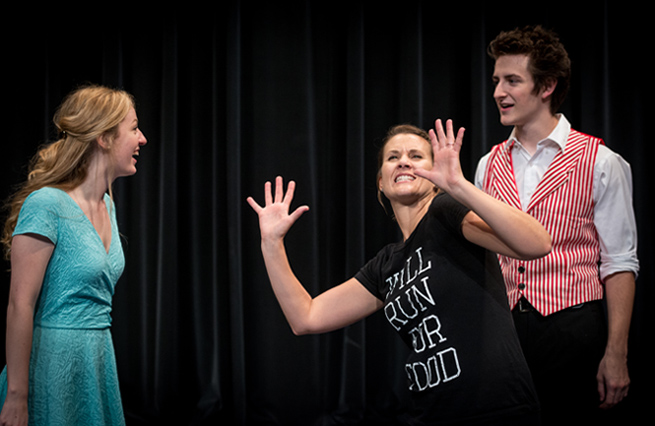 Director Dawne Meeks demonstrates some moves to Big Fish cast members Ryce Garren (Amos Calloway) and Sarah Yarbrough (Sandra Bloom).