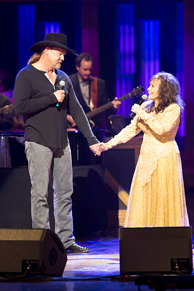 Opry performances blend newer and established country music stars such as Trace Adkins and Loretta Lynn. (Photo by -______)