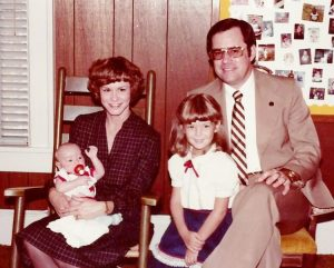 Trevor Rose as a child with his adoptive parents and sister