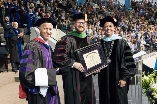Provost Dr. Robert Rhodes (left) and president Dr. Phil Schubert (right) presented Brantly with an honorary Doctor of Humane Letters degree.