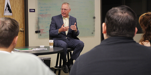 Lucado visits with students in the JMC newsroom