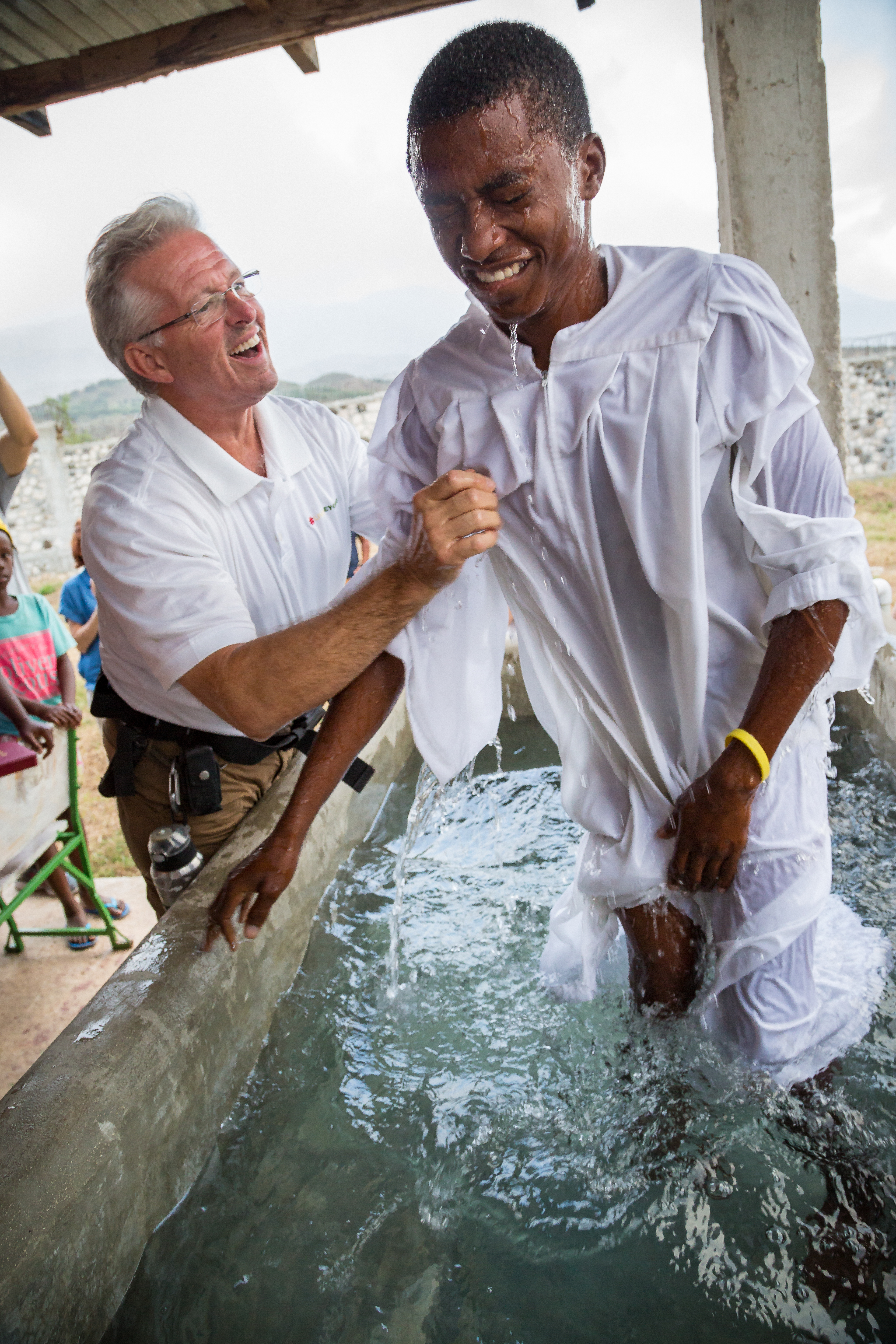 This young man was part of a whole family that was baptized in one day. And Haitians throw a party when there's a baptism! Being able to capture him right after coming up out of the water, and see it still washing over him, was really neat.