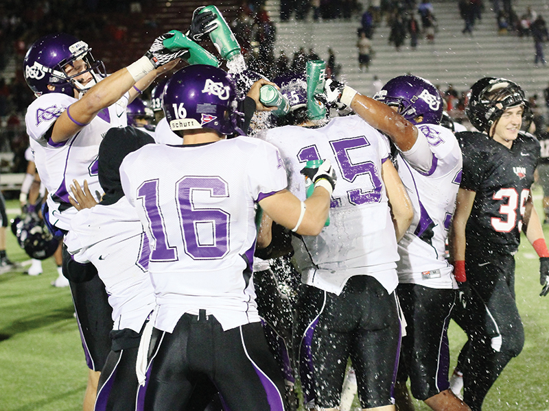 Teammates douse Mitchell Gale (15) after he became the ACU and LSC career passing leader following the 2012 game with Incarnate Word.