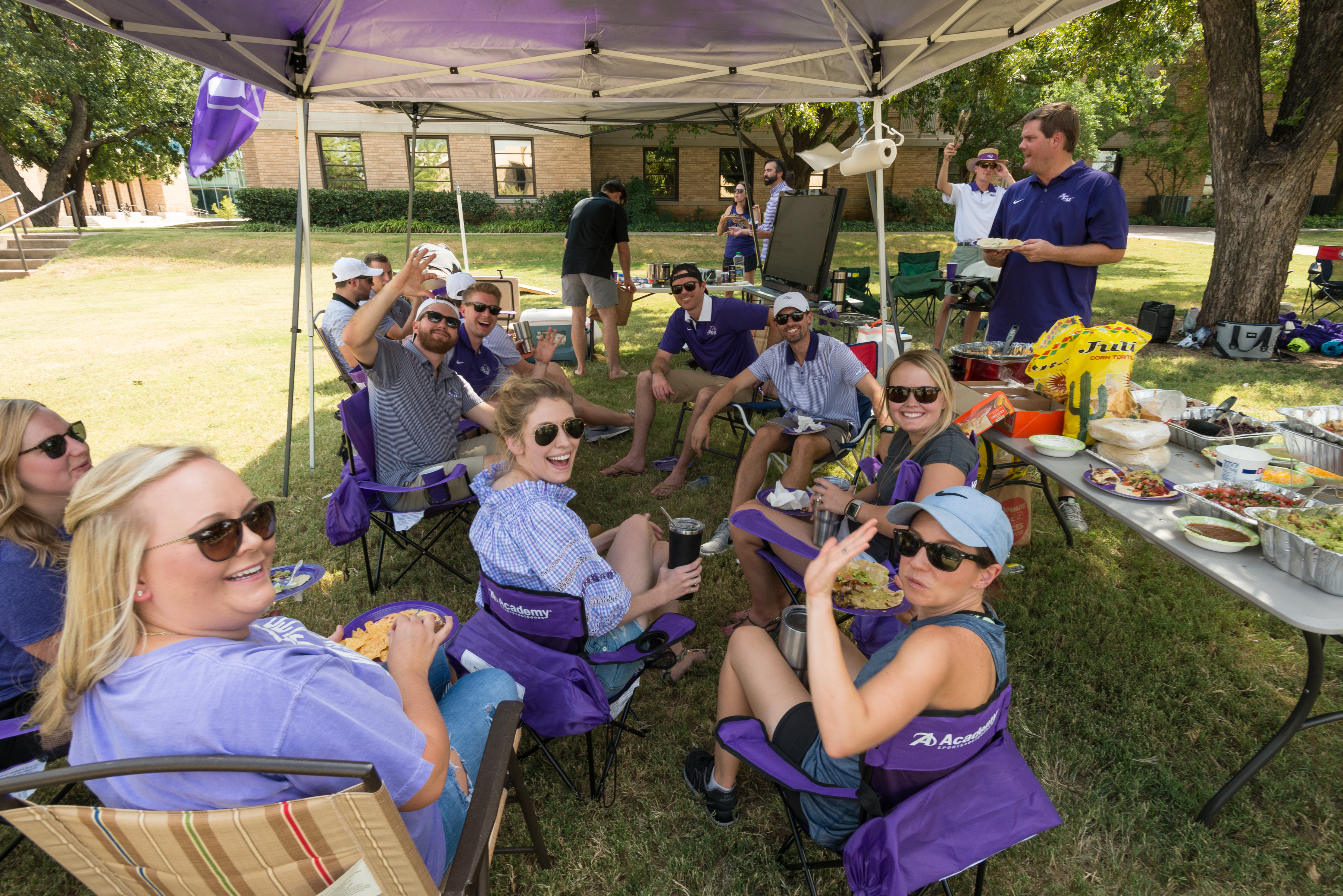 Garrett Sublette ('03), far right, and friends enjoy Wildcat Country Tailgating and Sublette's good eats on Opening Weekend of Anthony Field at Wildcat Stadium on Saturday, Sept. 16, 2017.