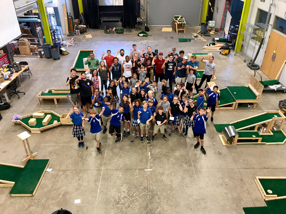 Abilene Christian Schools fifth-graders and ACU freshmen gathered for a photo after the students tested the mini golf course designed by engineering and physics students.