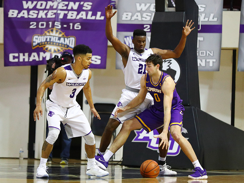 ACU guard Tevin Foster (3) and center Jalone Friday (21) guard Lipscomb forward Rob Marberry (0)