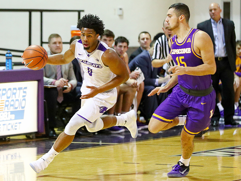 ACU guard Jaylen Franklin (0) drives on Lipscomb guard Andrew Fleming (15)