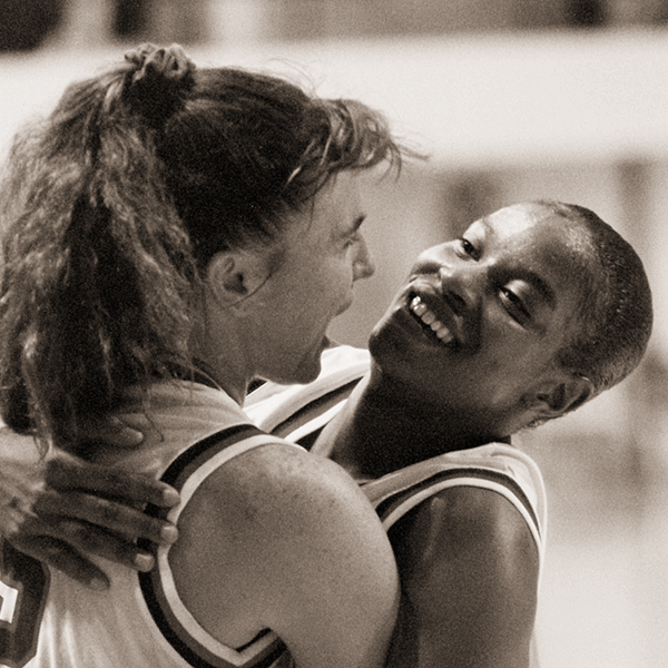 Jennifer (Clarkson '96) Frazier and Shalonda Bowden ('98) celebrate winning the NCAA Division II South Central region title in Moody in 1996. Frazier led ACU to a 49-game home court winning streak and the national tournament.