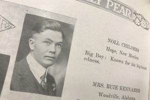 Three unmarked graves from WWI point to Wildcats who died serving their country