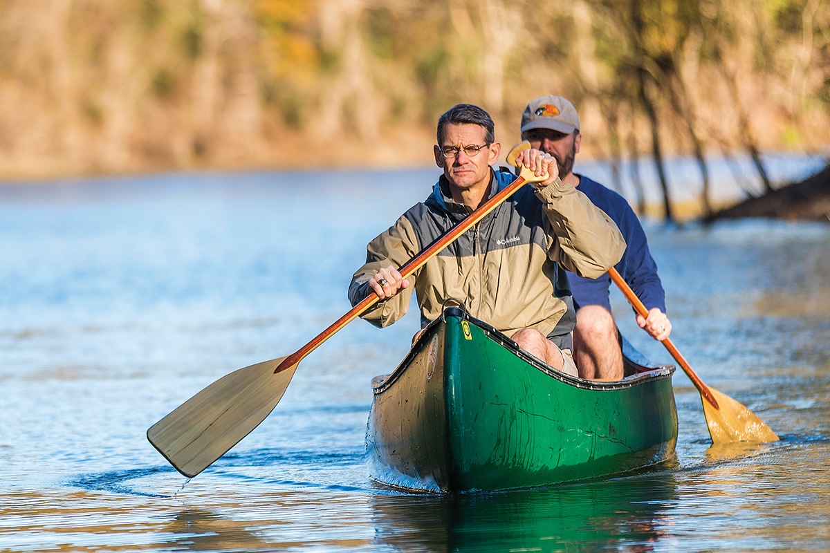 Lee McLeod (left) and Michael Pratt retrace waters in a Houston bayou where they used a canoe to rescue people last August (see inset photo). With a pricetag of $125 billion, Hurricane Harvey tied 2005 storm Katrina in causing the most damage of any tropical cyclone in U.S. history.