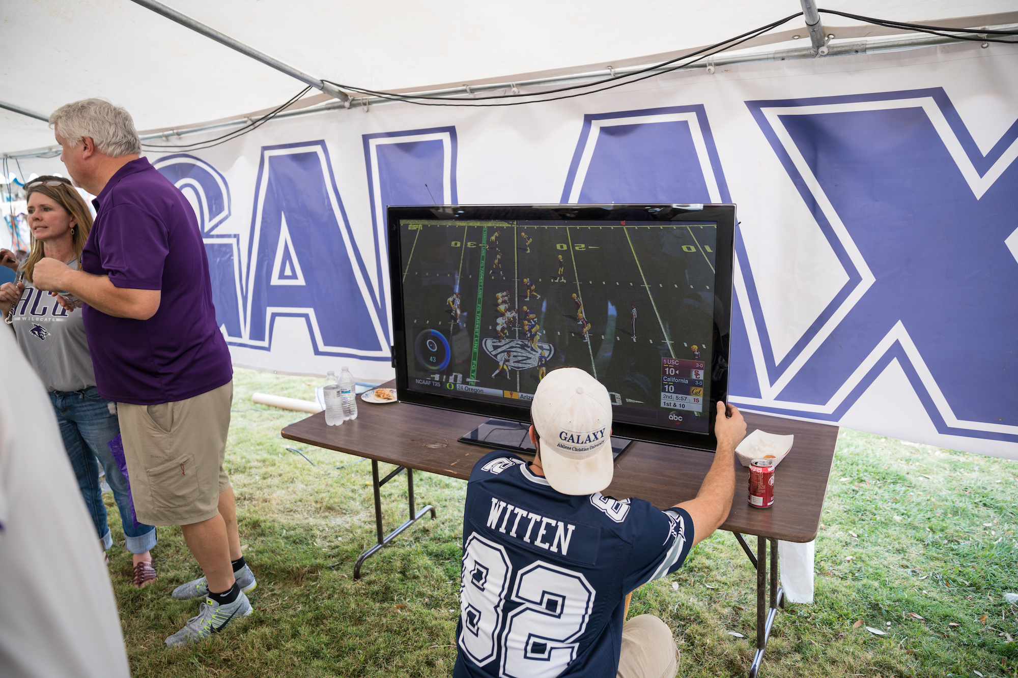 Galaxy members set up a big screen to monitor the action during their tailgate.