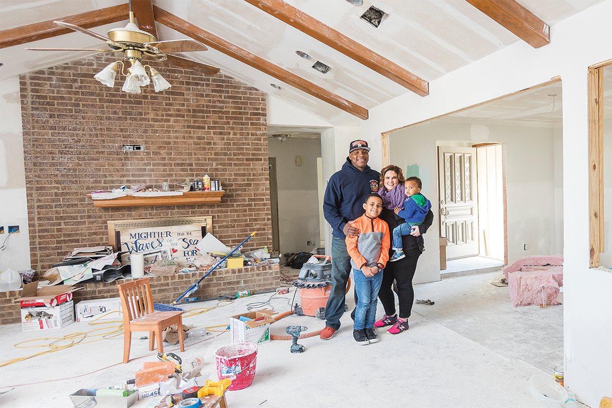 While firefighter Azzie Beagnyam (above, left) helped respond to the needs of people in Pearland, Texas, the house in Dickinson he and his wife, Ashlee, owned was severely damaged by flooding. The Beagnyams, including sons Lincoln and Boston, pose in January 2018 among the ongoing renovations as they put their home back together. They moved back in late March.