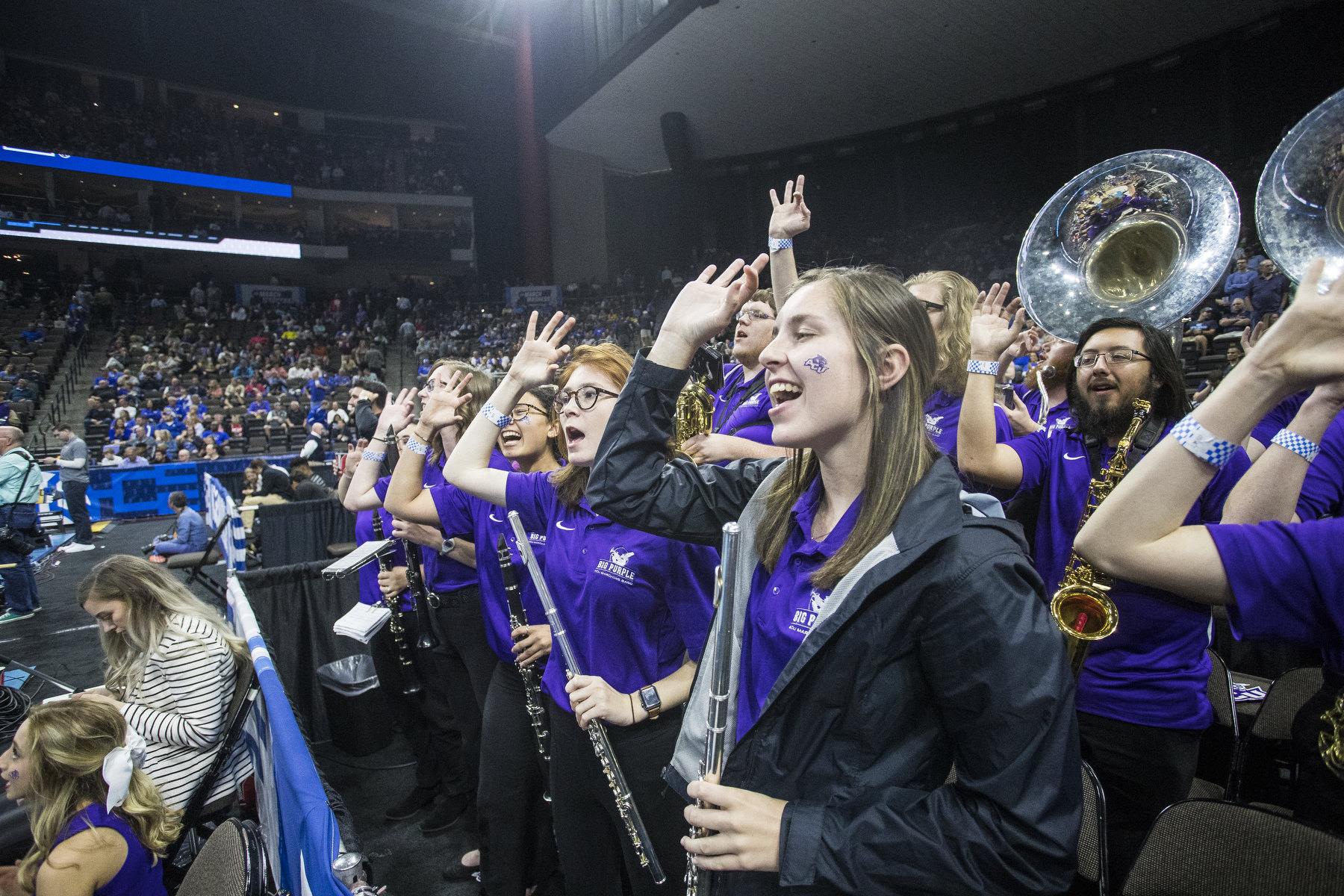 Between tunes, Big Purple basketball band members show their school spirit during Thursday night's ACU-Kentucky game in Jacksonville.