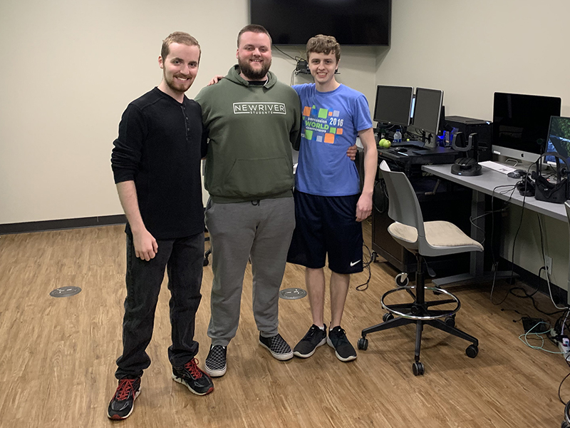 From left are game designers Andrew Thomas, Caleb Jackson and Bryce Gattis.