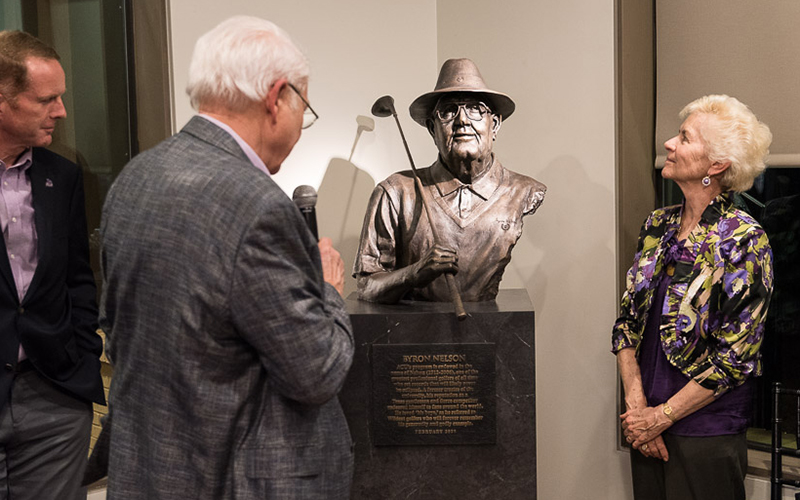 Head golf coach Tom Shaw, Jon Bradley ('72) and Peggy Nelson Jaros admire the bronze sculpture of Byron Nelson.