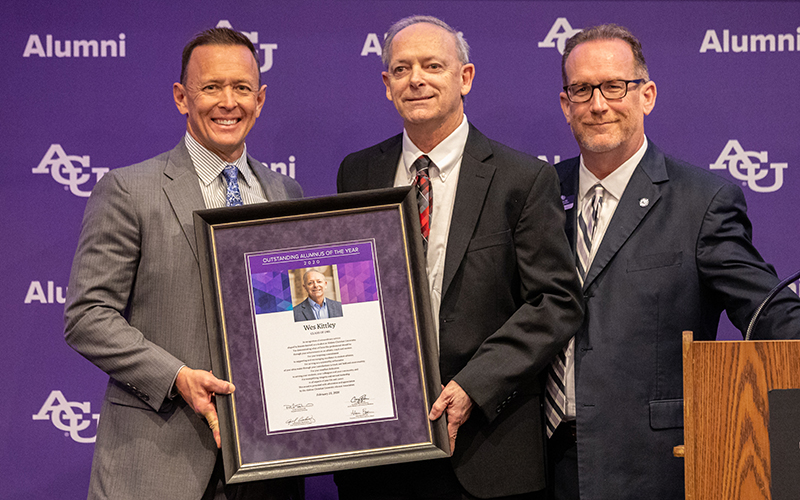 Dr. Phil Schubert ('91), president (right), and Craig Fisher ('92), assistant vice president of alumni and university relations (left), present Wes Kittley ('81), with his 2020 Outstanding Alumnus of the Year Award at the Alumni Day Luncheon on Feb. 23.