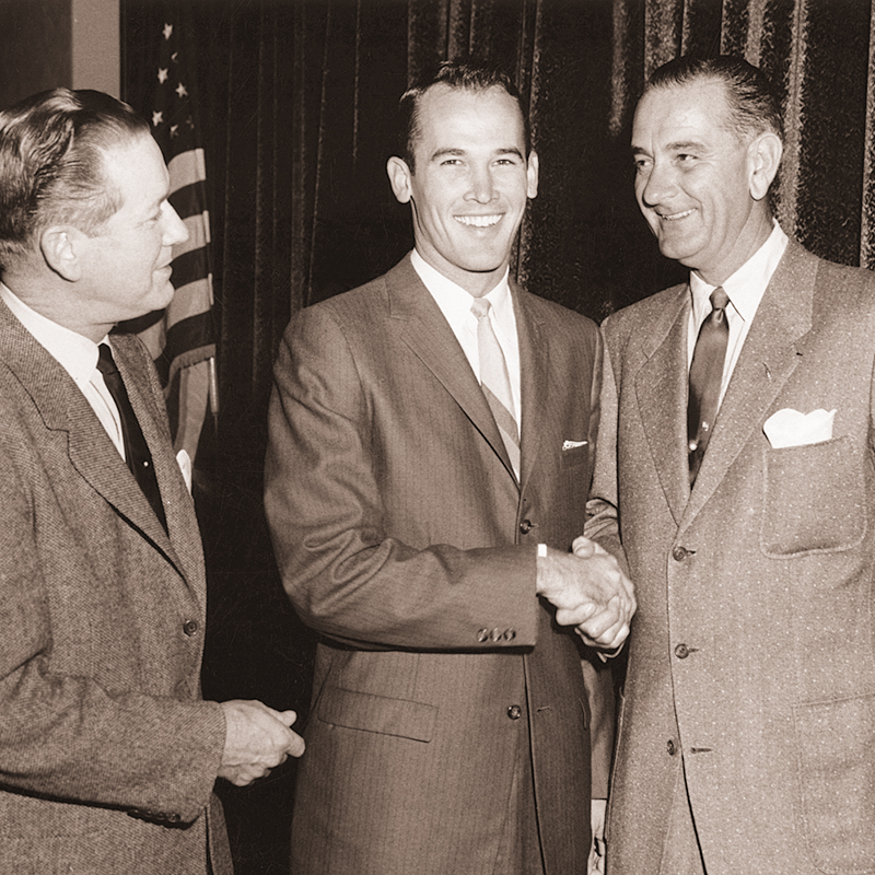 Texas Sen. Omar Burleson (left) watches as Bobby Morrow shakes hands with Texas governor Lyndon B. Johnson, who went on to become the 36th president of the U.S. Burleson was a 1928 ACU graduate.