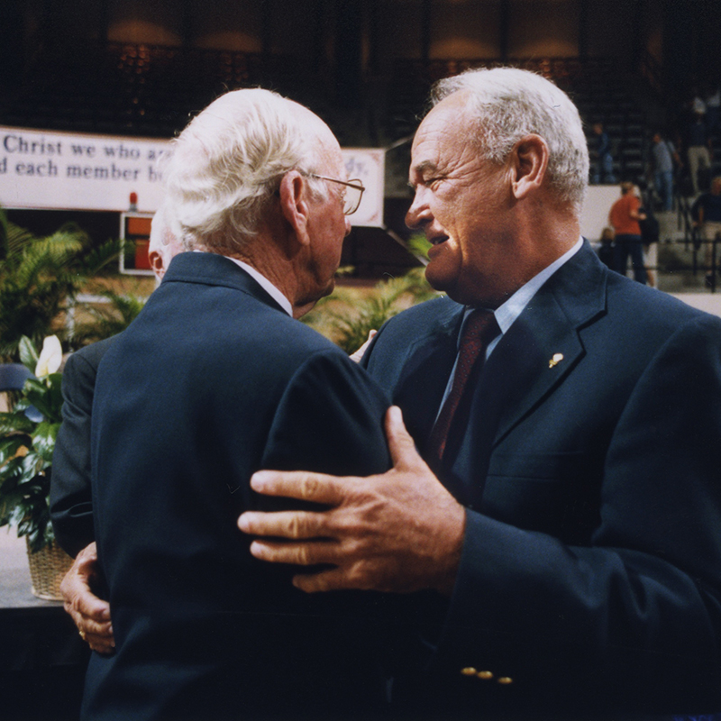 Morrow (right) embraces his beloved former head coach at ACU, Oliver Jackson (left), in 1999.