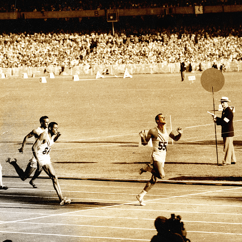 Morrow crosses the finish line in Melbourne, Australia, in 1956, where he won three gold medals and became a national hero.