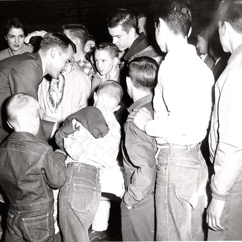 Olympic hero Bobby Morrow, who was admired by people of all ages, signs autographs for fans in 1958.