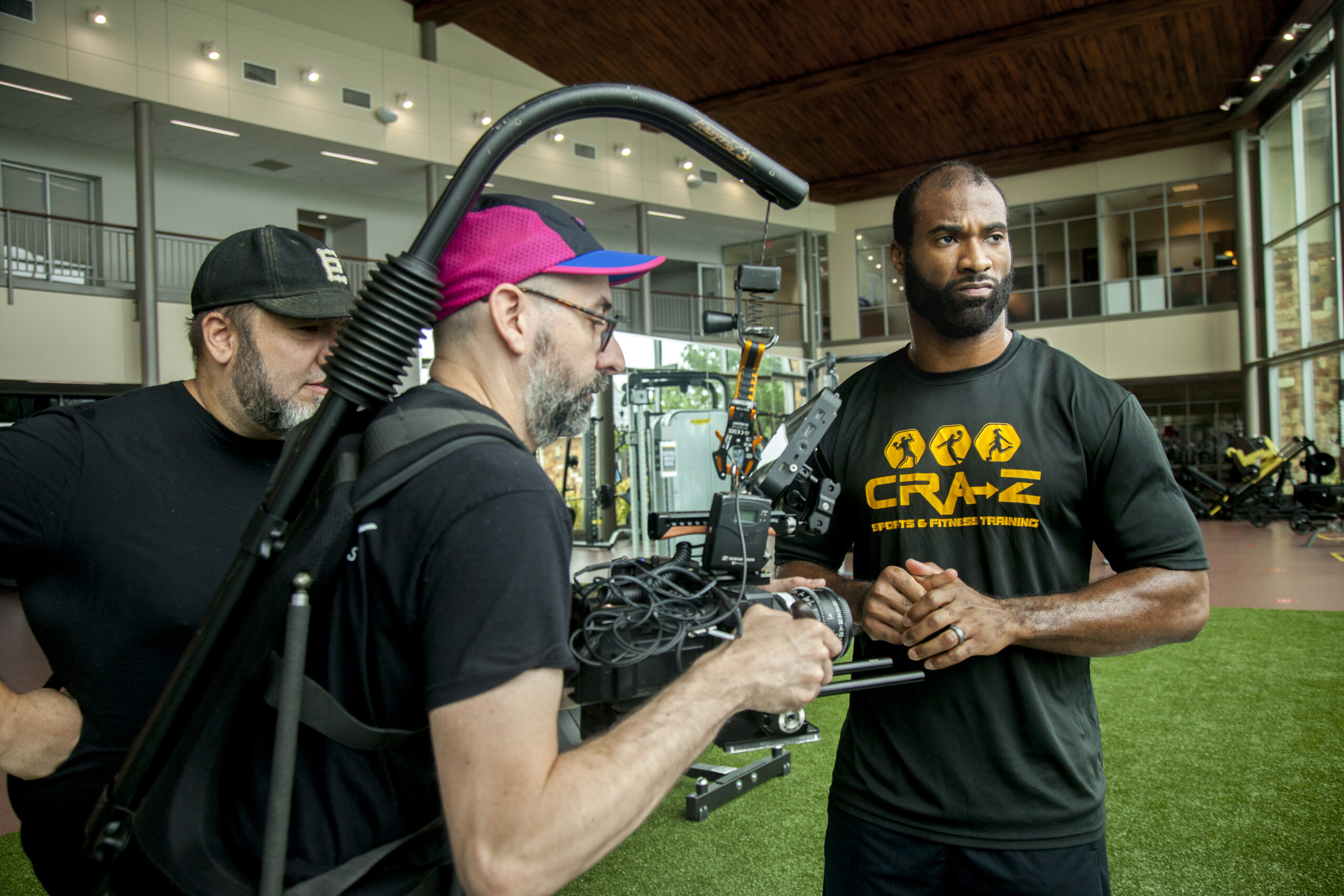 Zaviar Gooden (right), an online MBA student who played five seasons in the NFL, prepares to talk about his experience at ACU for a TV commercial.