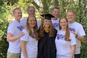 Newest grad puts bookend on Carroll family's 20-year purple and white legacy