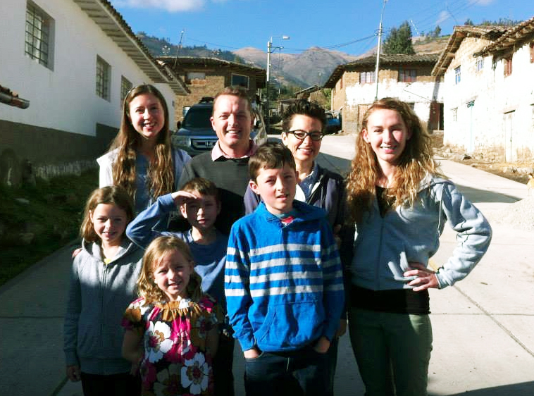 Haley McNeese (top left) poses with fellow WorldWide Witness intern Natali Schroeder and the Caire family in the summer of 2015 while the Caires were living in Peru.